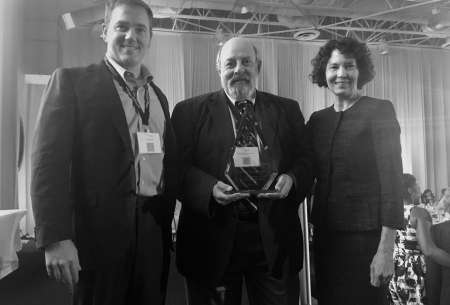 Pictures are L to R:  Drs. Erik Black, Richard Davidson and Amy Blue receiving the Beyond Flexner Award in Miami, FL